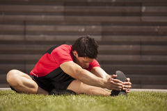 Athlete warming and stretching Stock Image