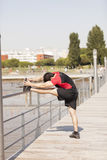 Athlete warming and stretching Royalty Free Stock Photos