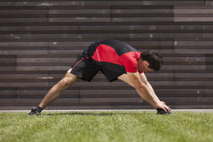 Athlete warming and stretching Stock Photo