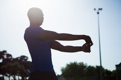 Athlete warming up in a stadium Stock Photo