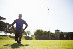 Athlete warming up in a stadium Royalty Free Stock Image