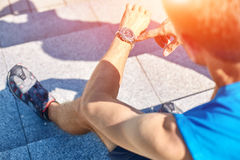 Athlete with watch Stock Images