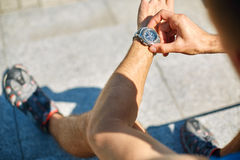 Athlete with watch Royalty Free Stock Photos