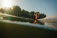 Athlete water skiing behind a boat Stock Photos