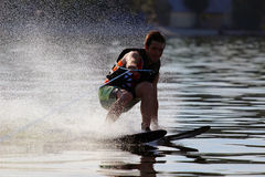 Athlete waterskiing. Athlete touches the water when riding on water skis stock photos