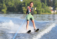Athlete waterskiing Stock Images