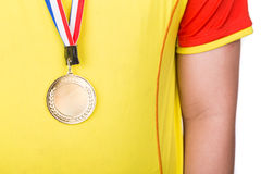 Athlete wearing generic gold medal with ribbon on his neck Royalty Free Stock Images