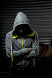 Athlete wearing hood with head down Royalty Free Stock Photography