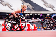 Athlete on wheelchair in London 2012 stadium. Athlete at the Visa London Disability Athletics Challenge at the Olympic Stadium in London on May 8, 2012. The Stock Image