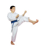 Athlete on a white background beat a kick leg Stock Image