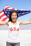 Athlete woman with american flag and USA t-shirt royalty free stock photography