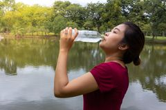 Athlete woman breaks and drinking water Royalty Free Stock Images