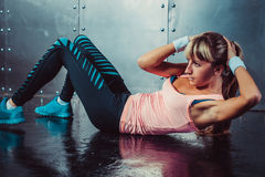Athlete woman doing abdominal crunches exercise Stock Photography