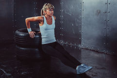 Athlete woman doing push-ups on bench training stock images