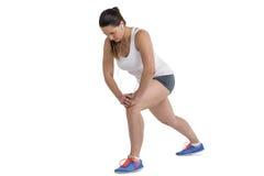 Athlete woman doing stretching exercise royalty free stock photos