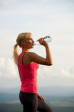 Athlete woman drink after workout Stock Images