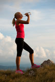 Athlete woman drink after workout Royalty Free Stock Photography