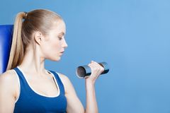 Athlete woman with dumbbells Royalty Free Stock Photography