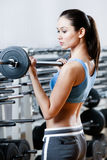 Athlete woman with dumbbells Stock Photos