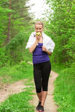 Athlete woman eating apple Royalty Free Stock Photo