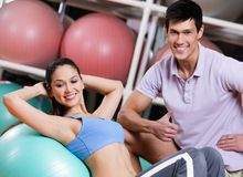 Athlete woman exercises in fitness gym Stock Images