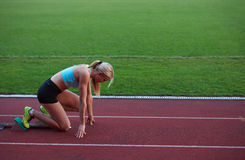 Athlete woman group  running on athletics race track Royalty Free Stock Image