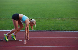 Athlete woman group  running on athletics race track Stock Photography