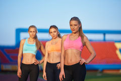 Athlete woman group  running on athletics race track Stock Photo