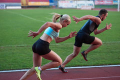 Athlete woman group running on athletics race track. Athlete women group running on athletics race track on soccer stadium and representing competition and royalty free stock photography