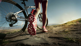 Athlete woman with her bike