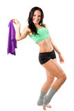 Athlete woman hold a towel after a workout. Beautiful athlete woman hold a towel after a workout at the gym on isolated white background. More of this series on royalty free stock photo