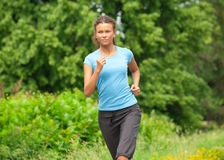 Athlete woman jogging outdoors Royalty Free Stock Photos