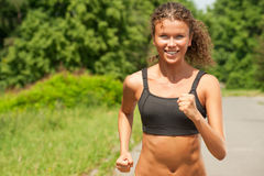 Athlete woman jogging outdoors stock image
