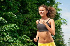 Athlete woman jogging outdoors Stock Photos