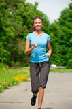Athlete woman jogging outdoors Royalty Free Stock Photography