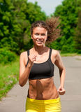Athlete woman jogging outdoors Royalty Free Stock Images