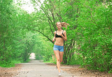 Athlete woman jogging outdoors Royalty Free Stock Image
