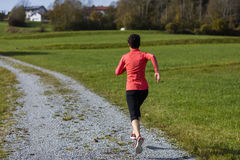 Athlete woman running outdoors Stock Image