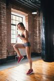 An athlete woman running on the spot in the gym. Mid shot stock images