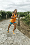 Athlete woman running Stock Images