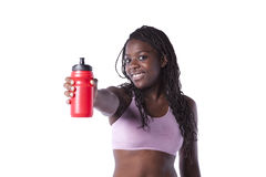 Athlete woman showing the water bottle Royalty Free Stock Photos