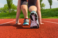 Athlete woman at starting line ready to run Royalty Free Stock Images