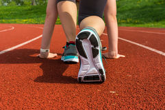 Athlete woman at starting line ready to run Stock Photos