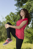Athlete woman stretching her legs after sports outdoors Royalty Free Stock Photography