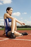 Athlete Woman Stretching On Racetrack Royalty Free Stock Photo