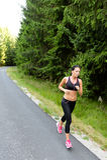 Athlete woman training for marathon run royalty free stock photos