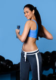 Athlete woman works out with dumbbells Stock Photo