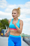 Athlete women's sportswear fit thin physique athletic build Royalty Free Stock Photography