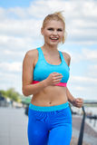 Athlete women's sportswear fit thin physique athletic build Stock Photography