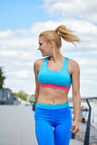 Athlete women's sportswear fit thin physique athletic build Royalty Free Stock Photo